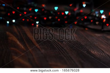 red and blue heart bokeh, Valentine's day concept on wooden background