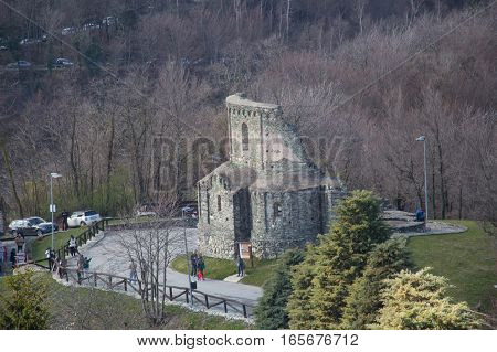 Italy Piedmont - April 5 2015: the view of landscape with San Sepolcro ruins in front of Saint Michael's Abbey on Mount Pirchiriano on April 05 2015 in Piedmont Italy.