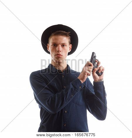 A man in a formal suit reloading a handgun