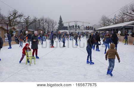 Amsterdam Nederland- December 302016: Children and adults skating at the rink