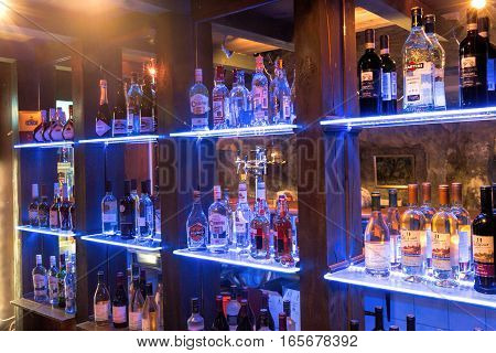 Moscow Russia - December 12 2016: Bottles of alcohol behind the bar