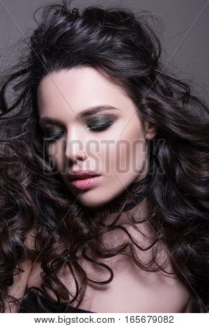 Close-up Portrait Of Beautiful Sensual Woman With Bright Makeup And Perfect Hairstyle.