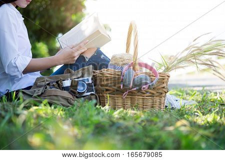 Relaxing Picnic In The Park And Reading A Book