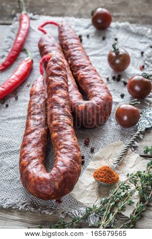 Chorizo with cherry tomatoes on the wooden table