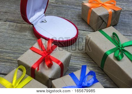Gift Boxes, Wrapping Paper With Colorful Ribbons On A Wooden Table And Gift Case