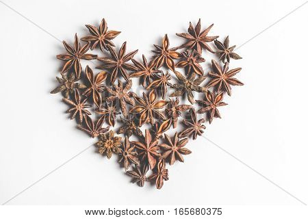 Star anise spice in the form of heart, isolated on a white background closeup