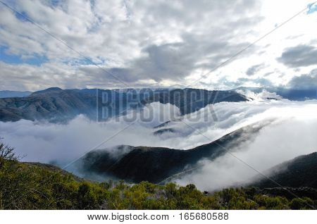 View over the clouds on top of the hill Cerro Arco close to Mendoza in Argentina South America