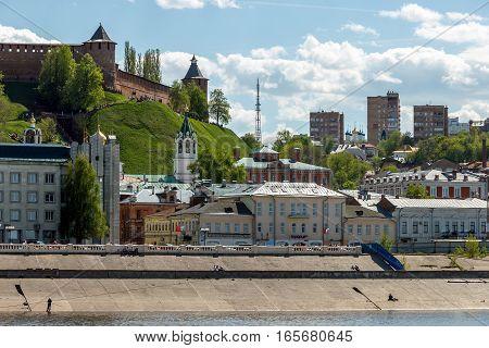 NIZHNY NOVGOROD, RUSSIA - MAY 09, 2016: Nizhny Novgorod Kremlin and the Nizhne-Volzhskaya Embankment. Roofs and domes over the old city