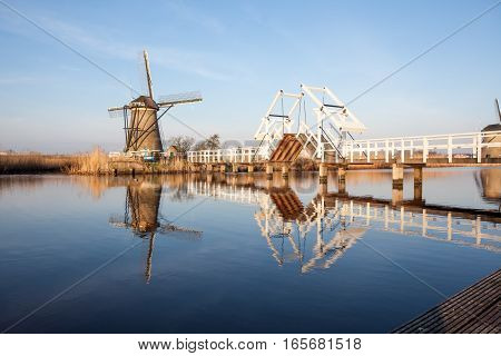 on the water there are several windmills in Kinderdijk in Holland