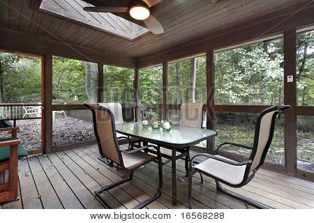 Wooden porch with skylights and outside deck