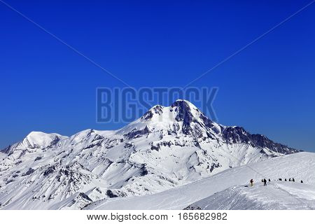 Off-piste Slope And Mount Kazbek At Sun Winter Day