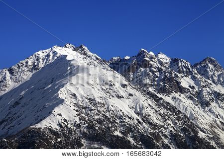Snowy Rocks And Blue Clear Sky At Nice Winter Day