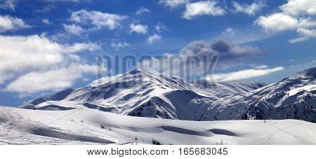 Panoramic View On Ski Slope And Beautiful Sky With Clouds In Sunny Evening