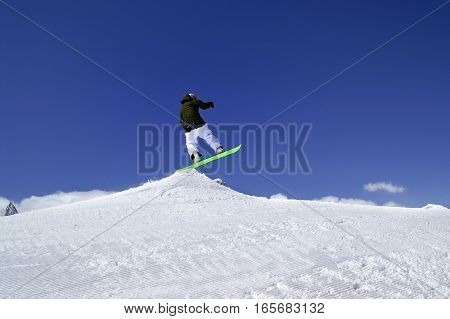 Snowboarder Jump In Snow Park At Ski Resort On Sun Winter Day
