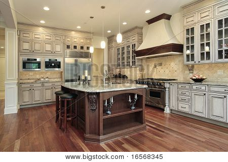 Kitchen in luxury home with rectangular island