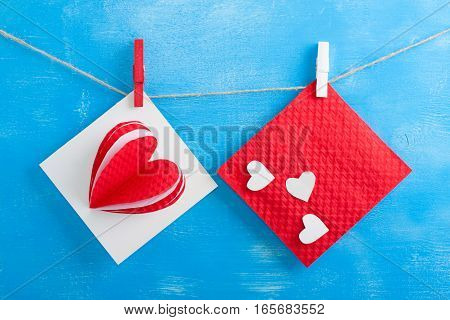White Gift Card And Red Envelope On Blue Wooden Background.