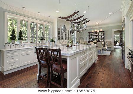 Kitchen in luxury home with white granite island