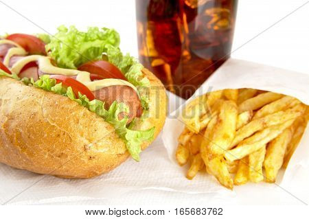 Hotdog With French Fries On Napkin With Glass Of Cola