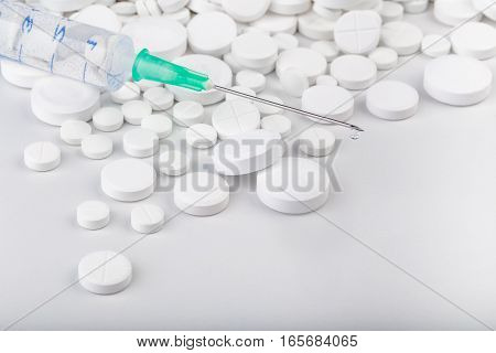 Bunch Of White Pills With Green Injection. Scattered Pills