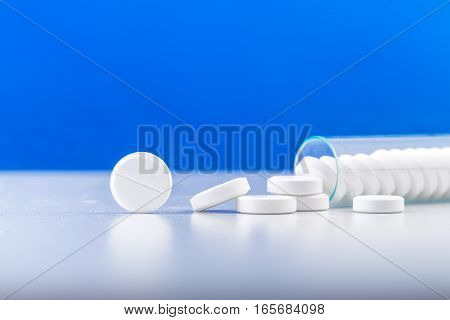 Bunch Of White Pills With Glass Ampoules.