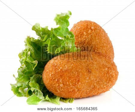 two fried breaded cutlet with lettuce isolated on white background.