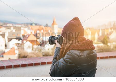 beautiful young female tourist photographing views of the European city