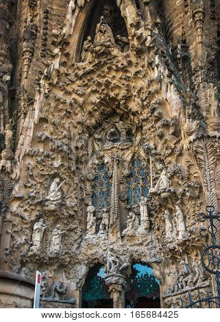 BARCELONA, SPAIN - DECEMBER 27: Fragment of Nativity facade of Sagrada Familia designed by Catalan architect Antoni Gaudi. Scene of the birth of Jesus. December 27, 2016, Barcelona. Vertical.