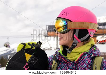 Portret of Snowboarder girl at Arhiz, Caucasian mountain.