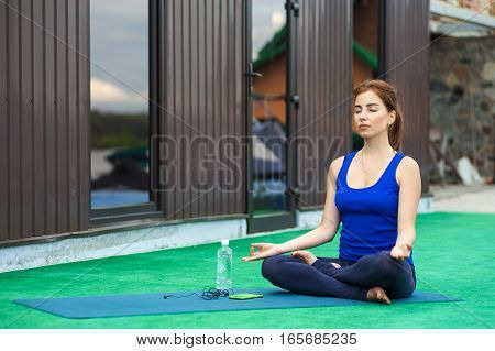 Young Woman Practicing Advanced Yoga Fitness Workout 20