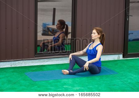Young Woman Practicing Advanced Yoga Fitness Workout 22