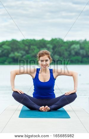 Young Woman Doing Yoga Exercise On Mat 32