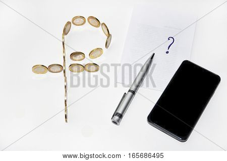 Rouble symbol builds from coins with pen on white background