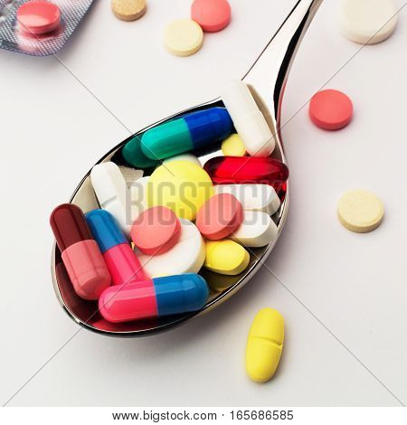 Medicine. A lot of pills into spoon