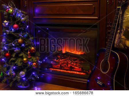 Christmas decoration in cozy house loft, fireplace Christmas tree guitar