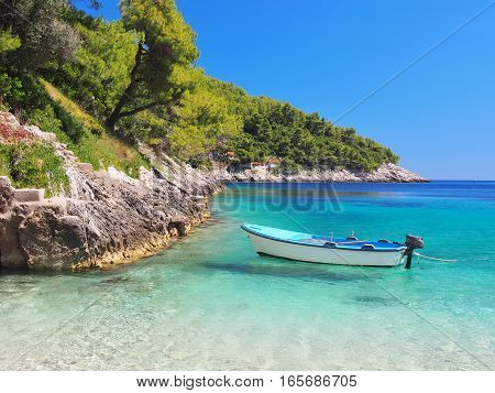 View from the beach of a boat on the sea