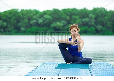 Young Woman Practicing Advanced Yoga Fitness Workout 29