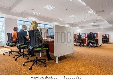 Modern IT classroom interior with orange carpet flooring