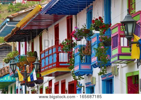 colourful colonial style wooden balconies with flowers in Salento Colombai