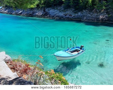 Boat on the bright, clear, blue sea