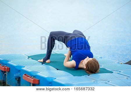 Young Woman Practicing Advanced Yoga Fitness Workout 27