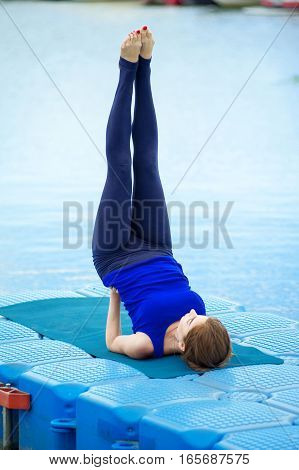 Young Woman Doing Yoga Exercise On Mat 25