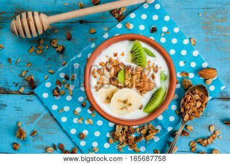 Healthy Breakfast: Yogurt With Granola, Banana And Kiwi