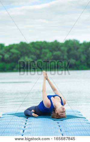Young Woman Practicing Advanced Yoga Fitness Workout 31