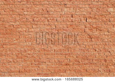wall made of red stone blocks - The color of the Italian stone has a marble looking surface and its color naturally resembles bricks.