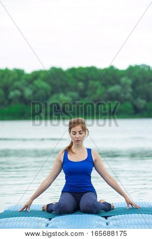 Young Woman Practicing Advanced Yoga Fitness Workout 34