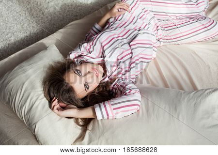 nice girl in pajamas morning bed sleep
