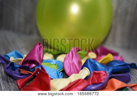 Colored balloons on a wooden table. Abstract composition party decor.