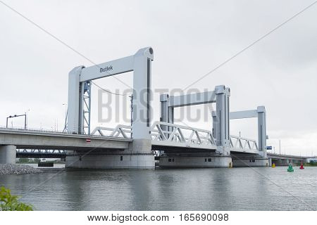 ROTTERDAM NETHERLANDS - MAY 5 2016: Botlek Bridge in the Rotterdam harbor area. The Botlek bridge is a combined lift bridge over the Old Maas river which opened in 1955 and was replaced by a new bridge in 2015