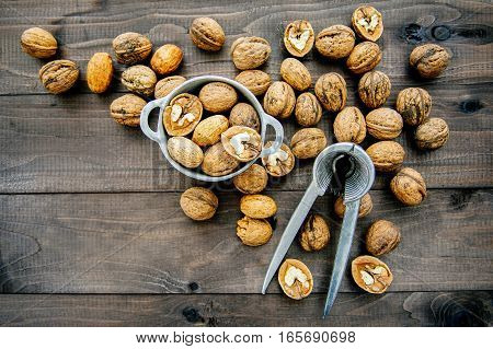 Walnuts and nutcracker on the wooden table