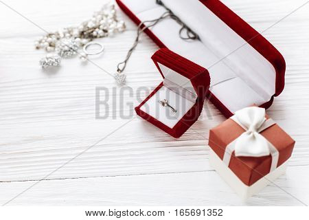 Stylish Diamond Ring In Red Present Box And Luxury Jewelry Accessories On White Rustic Wooden Backgr